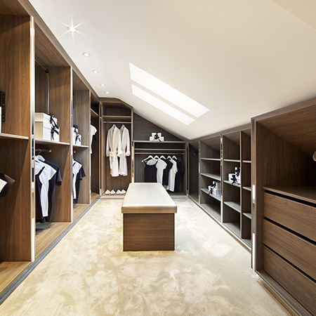 Fitted Wardrobes Ideas - Walk in wardrobe with open wardrobe storage and bedroom seat